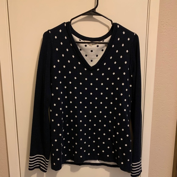 Navy blue sweater with white polka dots